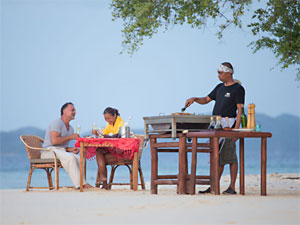 Dining on the beach at Bamboo Island, Philippines