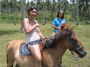 Ride a pony on Ticao Island, Philippines
