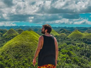 Man looking out over the Chocolate Hills, Bohol, Philippines