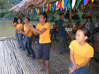 Local residents entertain tourists on the Loboc River, Bohol, Philippines