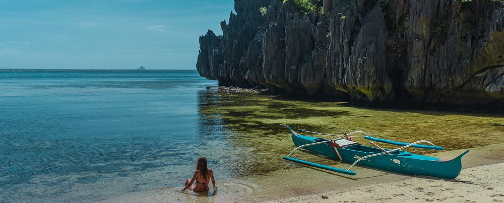 girl in sea by kayak in the Philippines